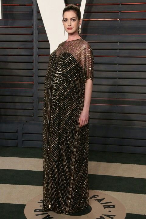 gold & black is classic but I think a long dress needs to be broken up a bit with that big of a bump... like a belt:
