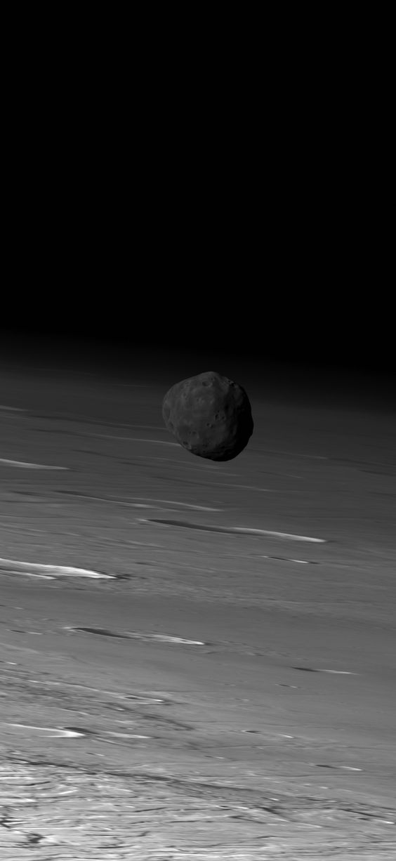 Phobos moon flying over the surface of Mars