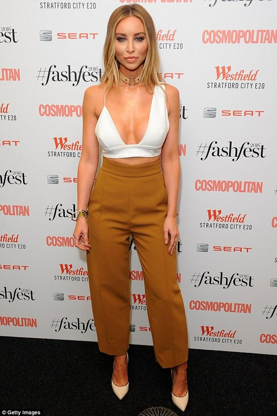 Busty: Lauren Pope showed off her assets in a plunging white crop top as…