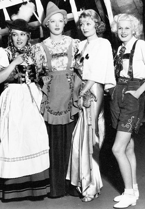 Gloria Swanson, Marion Davies, Constance Bennett and Jean Harlow at a Halloween costume party. ""