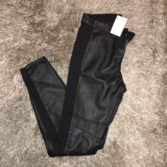 Black Faux Leather Leggings Black faux leather leggings with zip and button closure and single pocket on back. Fits like a 4/6. H&M Pants Leggings