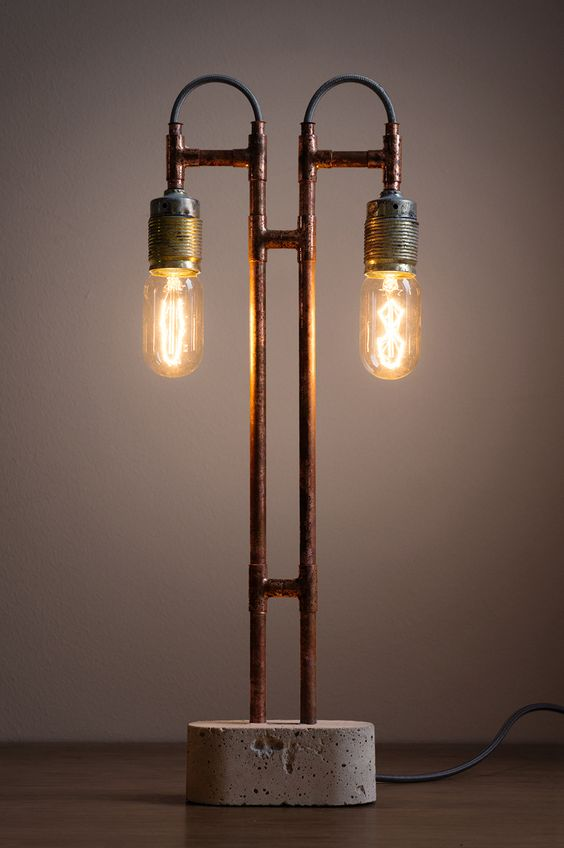 Industrial lamp made with brasspipes and concrete.