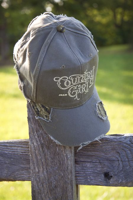 Country Girl ® Logo Frayed Camo Cap - Country Fashion Clothing | Our frayed camo hat features the frayed, distressed style and a pre-curved visor. The cap has sewn eyelets and velcro closure. One size fits most.