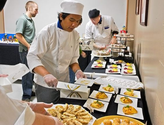 Students at the Institute for Culinary Arts at Mountain State University assist in serving their holiday pastries