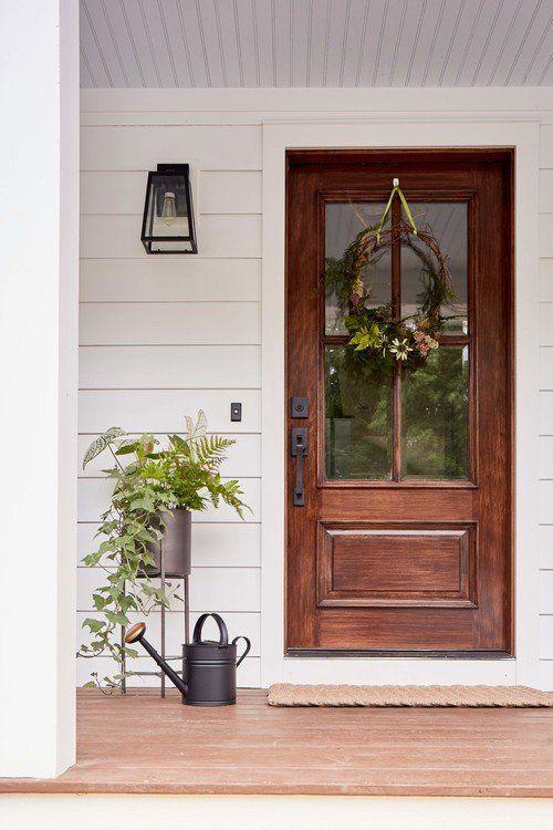 Create A Welcoming Front Door 7 Ideas Town Country Living Wooden Front Door Design Wooden Front Doors Front Door Decor
