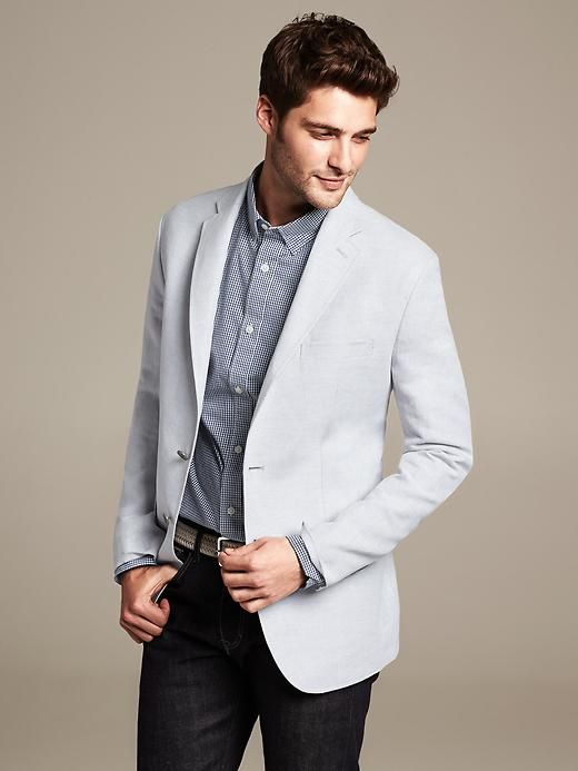 light gray linen-cotton blazer. blue checked shirt. white braided