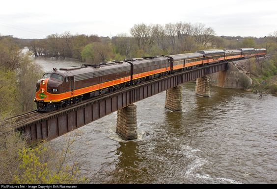 The CRSA Special utilizing 2 Iowa Pacific E8's and 5 matching cars crosses the Rock River after departing Janesville for the return trip to Chicago over the WSOR.