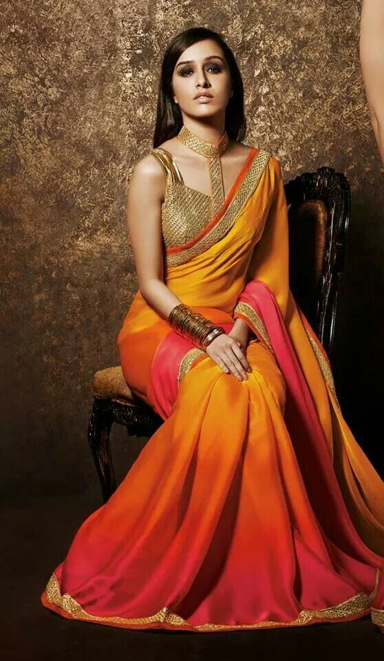 Golden embroidered blouse with yellow saree for bridal