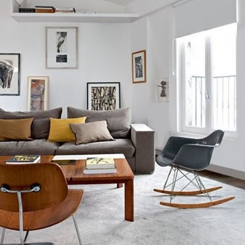 The Stunning a Spacious and Beautiful Loft a view of paris: the livingroom with a gray sofa and wood table in a Loft view of paris