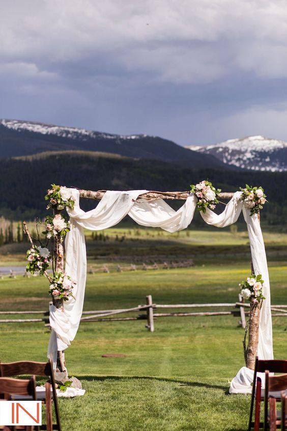 Devil's Thumb field ceremony arch with subtle draping - Plum Sage Flowers