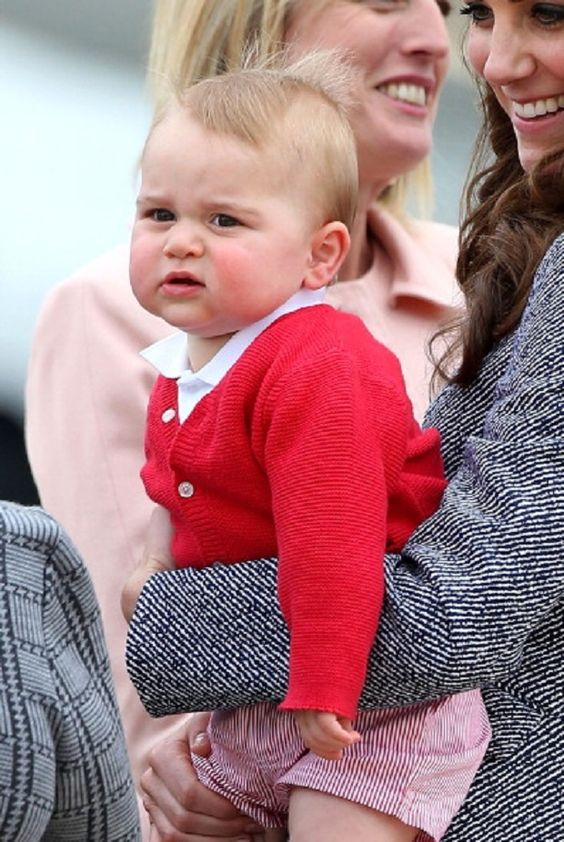 Prince George of Cambridge is seen in Catherine, Duchess of Cambridge arms as they depart from depart Fairbairn Defence Base, 25.04.14 in Canberra, Australia.