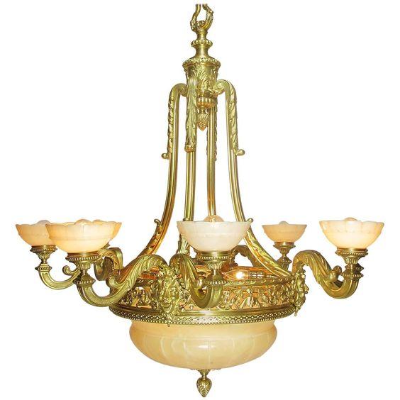 French Art Deco Gilt Bronze and Veined Alabaster Eight-Light Figural Chandelier…