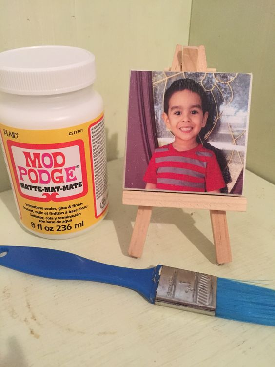 Decoupage with Mod Podge Matte. Use brush to coat back of picture and place on mini canvas (Walmart 97¢). Let dry, then coat thin layer of Mod Podge over picture and edges and dry for 10-15 min to seal. Place on mini easel (Walmart 97¢) and Voila! Happy Father's Day!