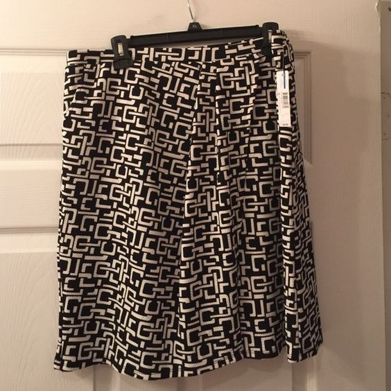 New faux wrap skirt with pockets New with tags faux wrap skirt with pockets. Stretchable fabric new directions Skirts
