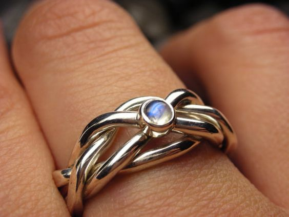 Narrow puzzle ring in sterling silver with a natural moonstone cabochon