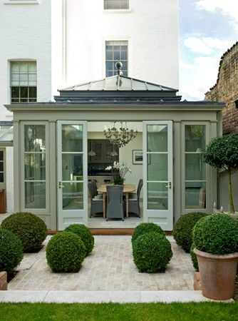 Gorgeous conservatory with topiary box balls. Try Little Greene Normandy Grey for a similar soft, chalky grey green paint. Details on Relics Of Witney blog