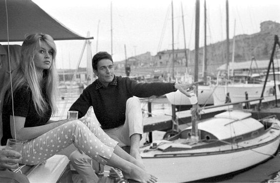 """chivalryrevived: Brigitte Bardot and husband Jacques Charrier christen their new boat """"Le Babette"""" with champagne, June 1959."""