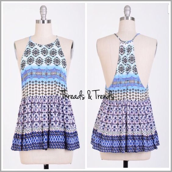Pretty In Periwinkle Halter Top Simply adorable halter top with T back detail. In a vintage print pattern of periwinkle, shades of blues and greens. A must have for your summer wardrobe. Made of a cool summer rayon/spandex fabric.  Size S, M, L Threads & Trends Tops