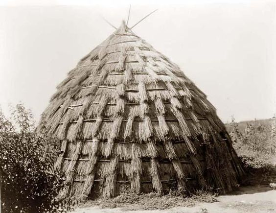 You are viewing a rare image of a Wichita Grass-house. It was taken in 1927 by Edward S. Curtis.    The image shows a nice view of this traditional Wachita Home.    We have created this collection of images primarily to serve as an easy to access educational tool. Contact curator@old-picture.com.    Image ID# FB94850E