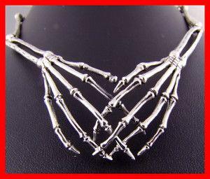 silver skeleton hands necklace