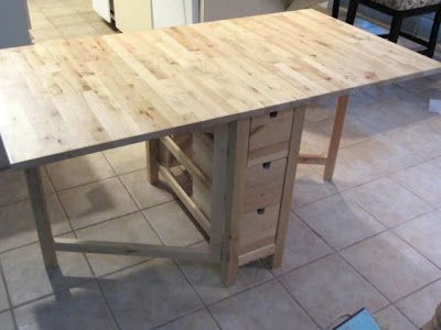 Foldable IKEA table as a craft room table with built in storage