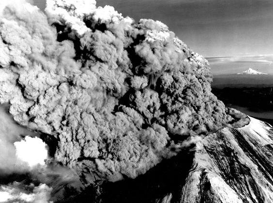 Mount St. Helens looking toward the southeast on May 18, 1980, shows a very close view of the crater and eruption, with snow-covered Mount Hood in the distant horizon. Skamania County, Washington.