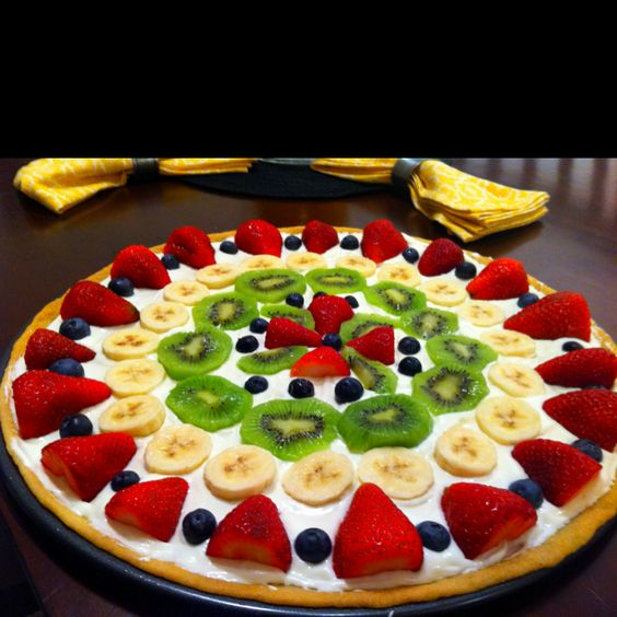 "fruit pizza: instead of the traditional cream cheese/cool whip ""sauce,"" use 8oz cream cheese, 7oz marshmallow fluff, 1/4 cup powdered sugar, and 1/2 tsp vanilla extract. You'll never go back! Yum!"