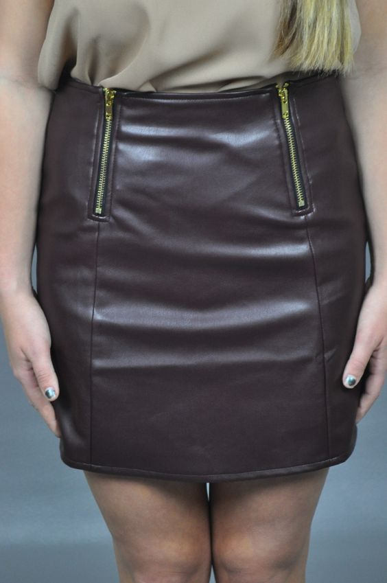 """$52   This leather skirt is a rock star and made for those rock star """"wanna bes."""" The maroon tint, front zipper embellishments and perfect fit make this leather skirt a season's must have. Add it to your closet today."""