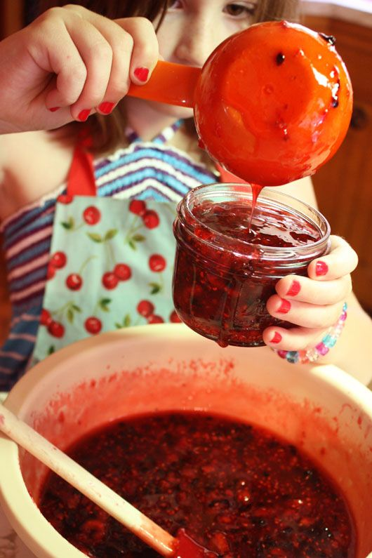 filling jars with raspberry-blackberry freezer jam. I've made this jam for the last few years.... Once you make it homemade you will never buy a jar of cooked jam off the shelf!