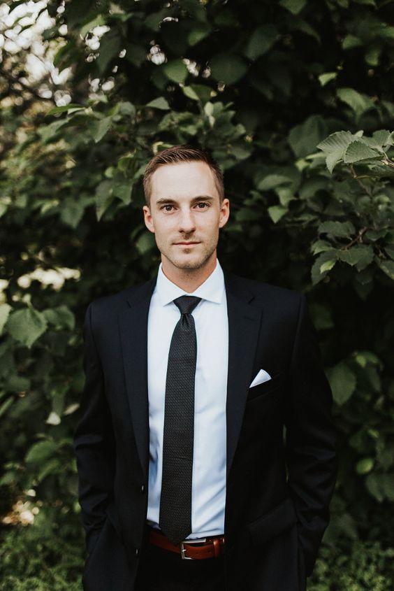 groom in classic black suit