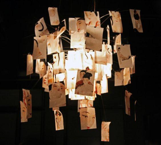 ingo maurer's '5 chandelier', variation for milan design week 2012, at spazio krizia — at Milan Design Week.