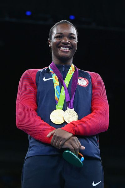 Gold medalist Claressa Maria Shields of the United States poses on the podium during the medal ceremony for the Women's Boxing Middle (69-75kg) on Day 16 of the Rio 2016 Olympic Games at Riocentro - Pavilion 6 on August 21, 2016 in Rio de Janeiro, Brazil.
