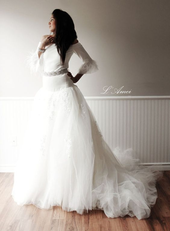 This wedding dress is gorgeous, glam, feminine, sexy and unique. It is a part of our 2015 collection with a fresh new design. A simple, princess style
