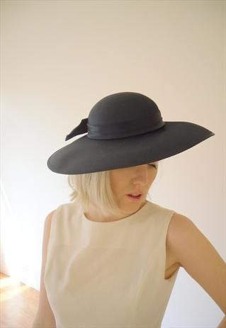 Vintage Classic Chic Navy Blue Hat with Bow Detail https://marketplace.asos.com/listing/hats/classic-chic-navy-blue-hat-with-bow-detail/293464