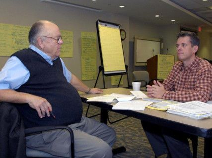 Alban Consultant Ed White, left, and David Pratt, a former Alban Director of Marketing, work during a meeting. Photo courtesy of West End S...