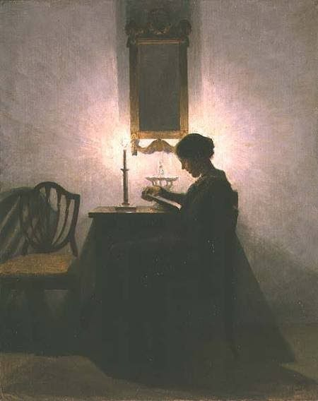 'Woman Reading by Candlelight' by Peter Ilsted