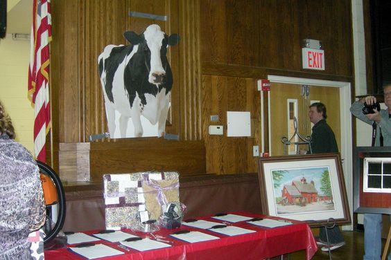 Silent Auction table at 15th Annual Barn Dance Fundraiser. #communitygiving