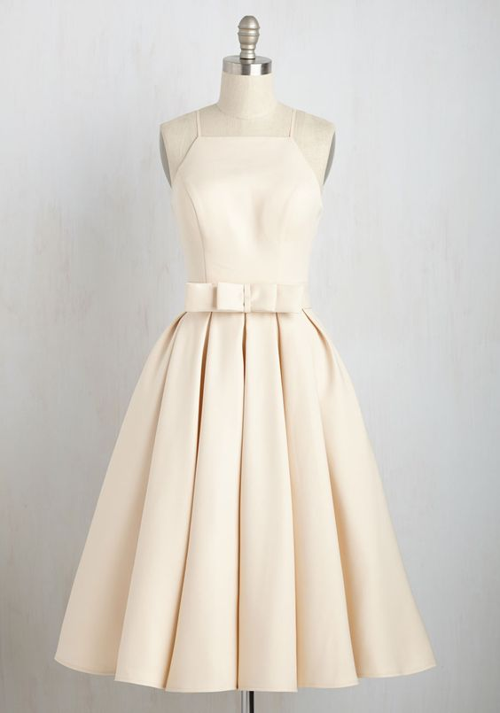 You'll be the picture of poise when you drift down the aisle in this elegant dress by Chi Chi London. Boasting a high neck and backline, a bow-adorned belt, and a voluminously pleated skirt, this delicate beige dress imbues every sophisticated step you take with style and grace. By the way, this lovely item will be available for purchase in April!