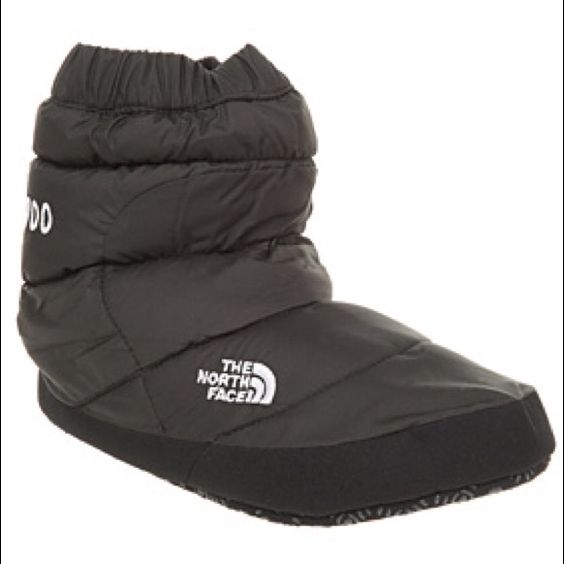 North Face Down Slippers North Face down booties. Great for slippers at home or for around the camp fire. I have only ever used these once on a camping trip. Excellent condition. North Face Shoes