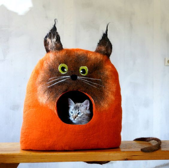 Super cute felted cat caves like this adorable orange kitty are great cat beds as well as conversation pieces. The definition of spiffy pet stuff.: