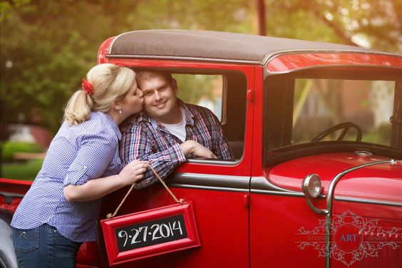 A casual engagement photo shoot before a formal red and navy wedding. Vintage Ford truck belongs to the groom's father. Photo by StudioArtMaria.