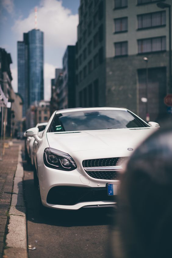 """Frankfurt is a powerhouse of a city, a nucleus of vertiginous skyscrapers earning it the local nickname """"Mainhattan"""", after the adjacent Main River. Join the Mercedes-Benz SLC on a roadtrip through the city of Frankfurt, Germany. Photo via Mercedes-Benz Deutschland."""