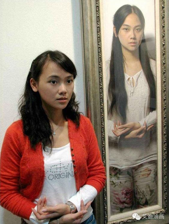Leng Jun, artist standing next to one of her paintings