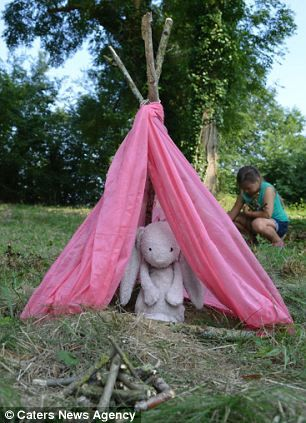 Pink bunny with a teepee