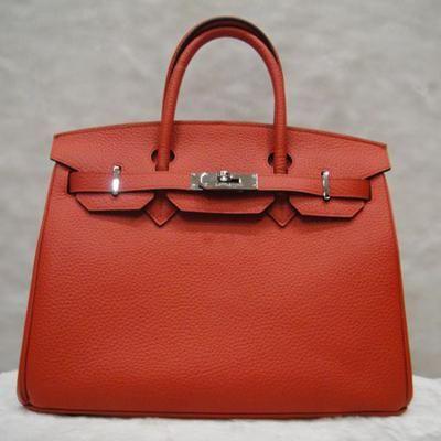 Birkin handbag in red by Hermès