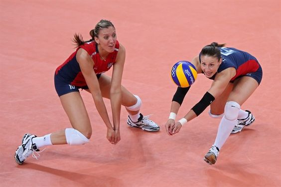 Best Of London: Day 13 -Nicole Davis #6 and Jordan Larson #10 of the USA go after the server against Korea during Women's Volleyball semifinal match