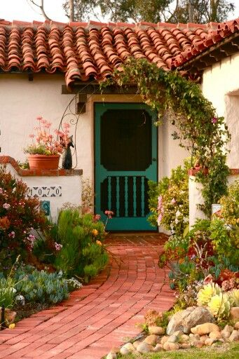 Spanish style home green screen door and green garden for Spanish style roof tiles