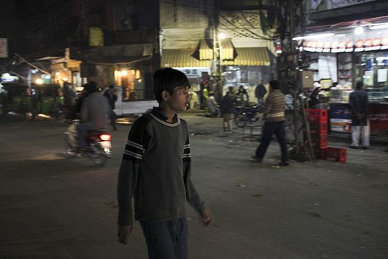 """Zeshan (age 13) began life on the streets after his father died and his mother abandoned him. He now lives in a shelter in Lahore, Pakistan. His basic needs are met, but Zeshan says that children are beaten there. He works long hours at a gaming parlour to earn about US$0.50 a day. """"I wish my parents … were with me,"""" he said. """"I could go to school … I could have a decent life.""""  ©UNICEF/Asad Zaidi - To learn more: www.unicef.org/photography"""
