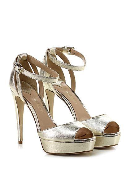 THE SELLER - Sandalo alto - Donna - Sandalo alto in pelle laminata vintage con cinturino alla caviglia e suola in cuoio. Tacco 125, platform 35 con battuta 90. - PLATINO - € 198.00