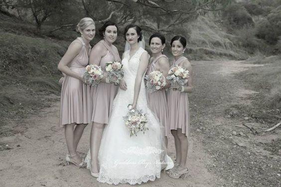The vintage style shoot here just looks amazing with the @goddessbynature bridal party in their signature cocktail dresses in Dust Me Pink colour.